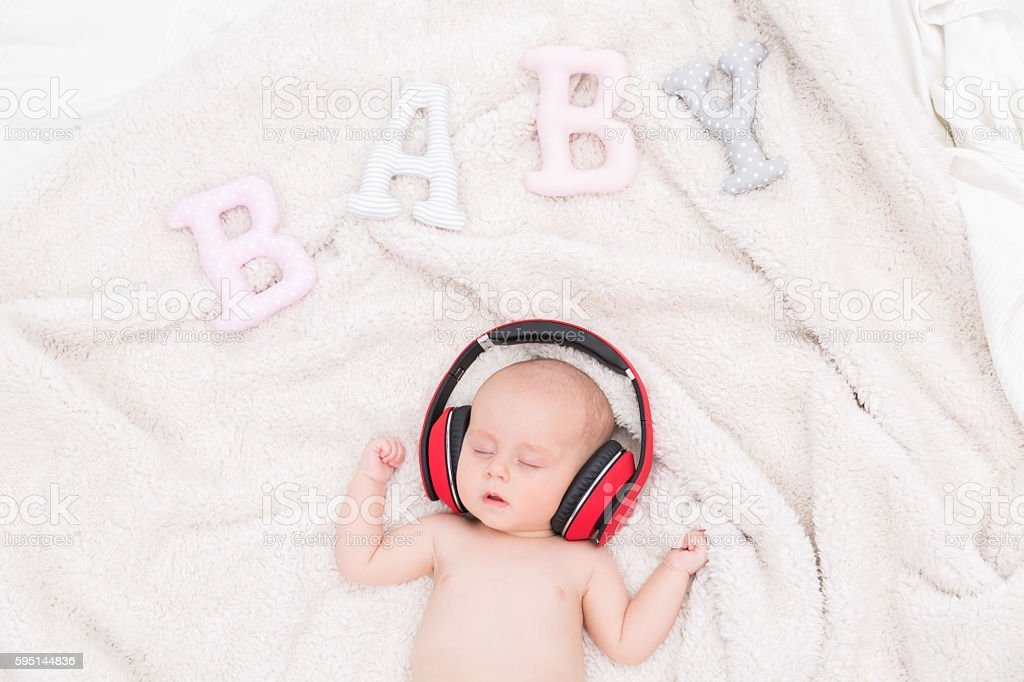 With music, she instantly falls asleep stock photo