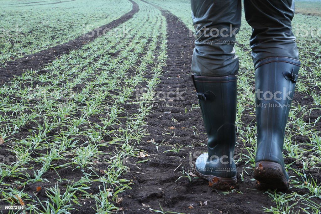 With rubber boots along the lane - Royalty-free Adult Stock Photo
