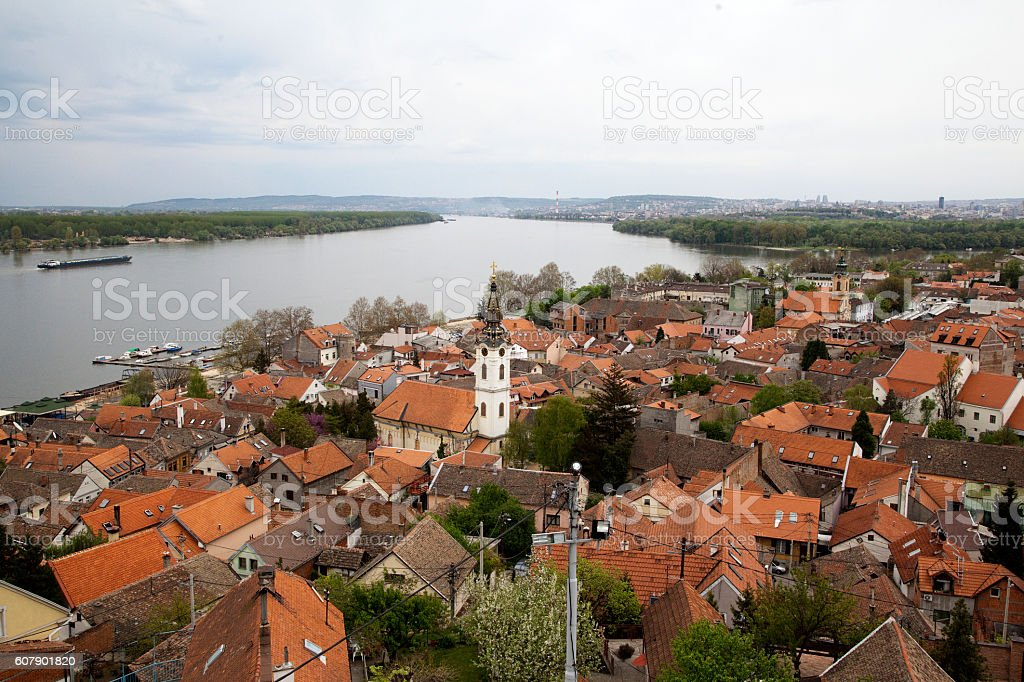 With Saint Nicholas church baroque bell tower and river Danube. stock photo