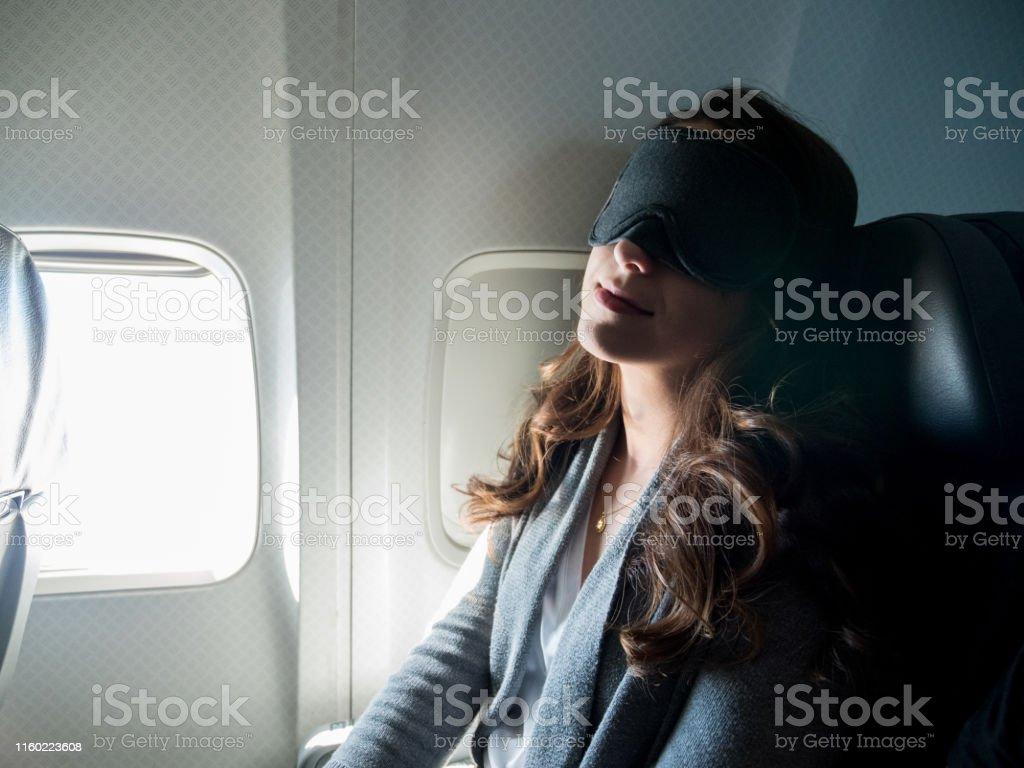 With her mask on to help her sleep, the woman gets good, deep sleep...