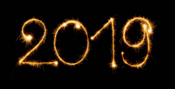 2019 with sparklers on black background stock photo