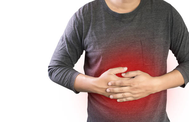 MAN with symptomatic acid reflux , suffering from acid reflux at park stock photo
