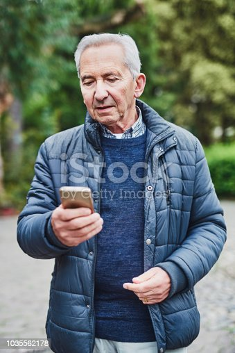 Shot of a senior man using a mobile phone in the park