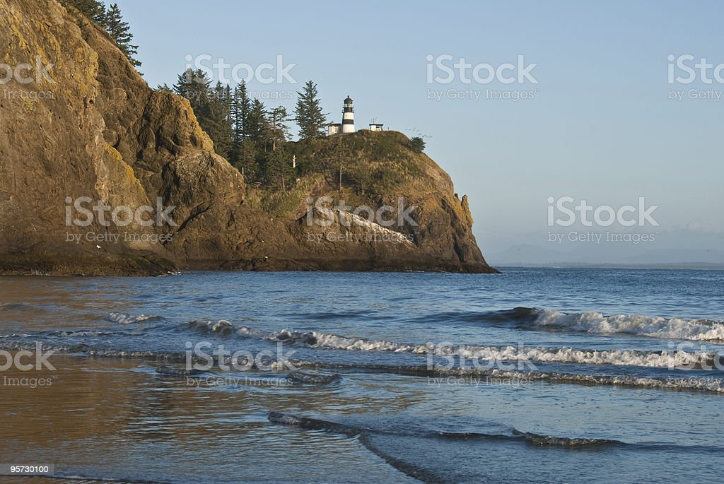 Lighthouse at Cape Disappointment Reflected in the Pacific Ocean stock photo