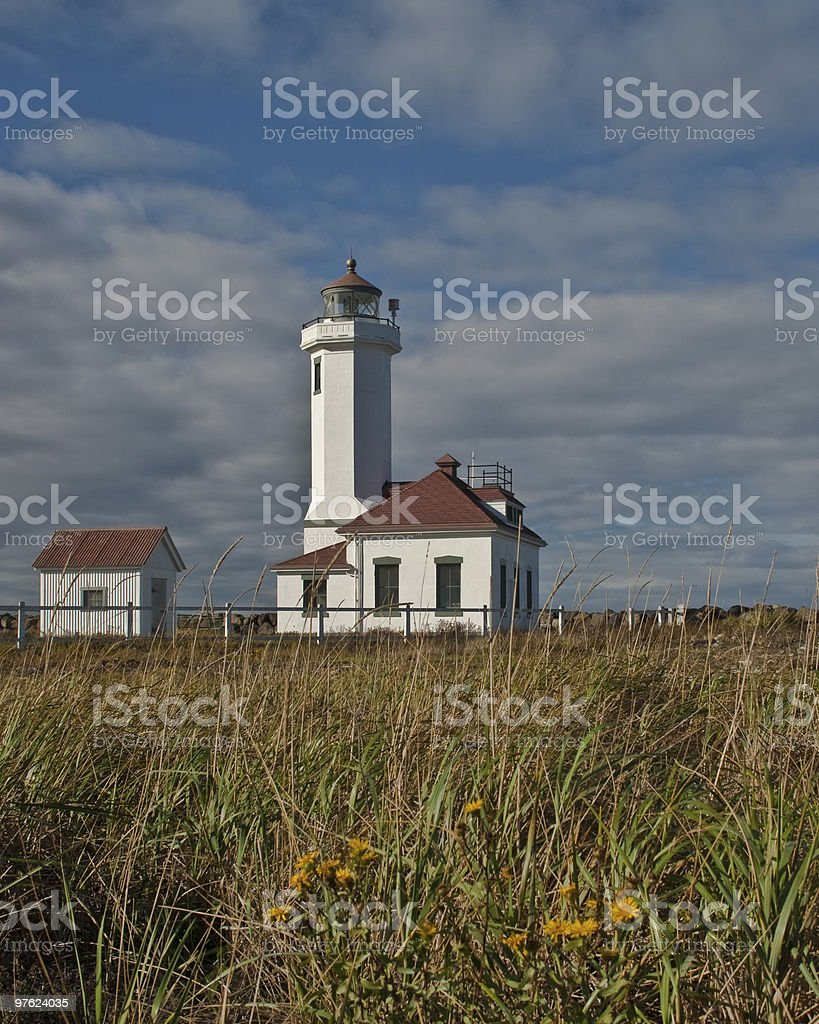 Point Wilson Lighthouse and Grassy Foreground royalty-free stock photo