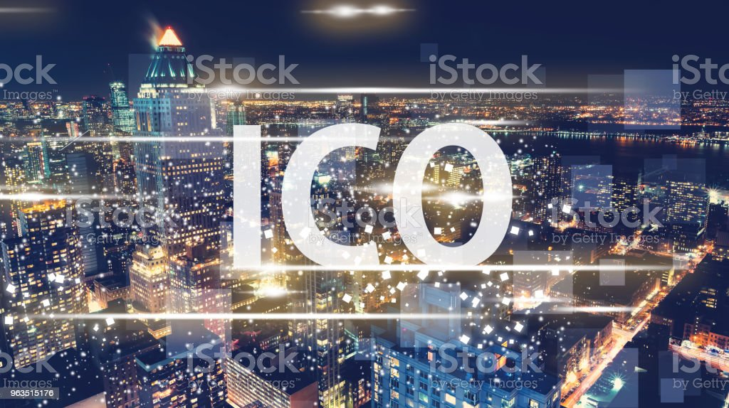 ICO with the New York City skyline ICO with the New York City skyline at night Architecture Stock Photo