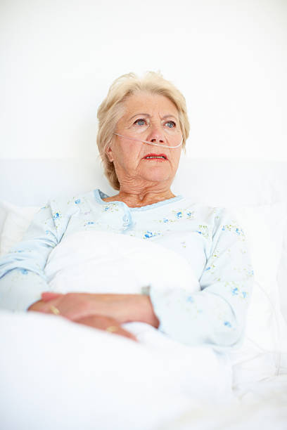 With the right hospital plan you won't have to worry Ailing senior woman looks away as she contemplates her illness - Copyspace oxygen tube stock pictures, royalty-free photos & images