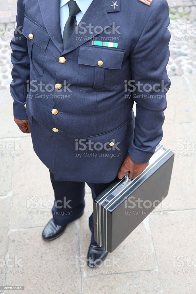 COP with the suitcase after payment of a bribe stock photo