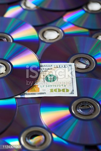 DVD/CD with US dollar note
