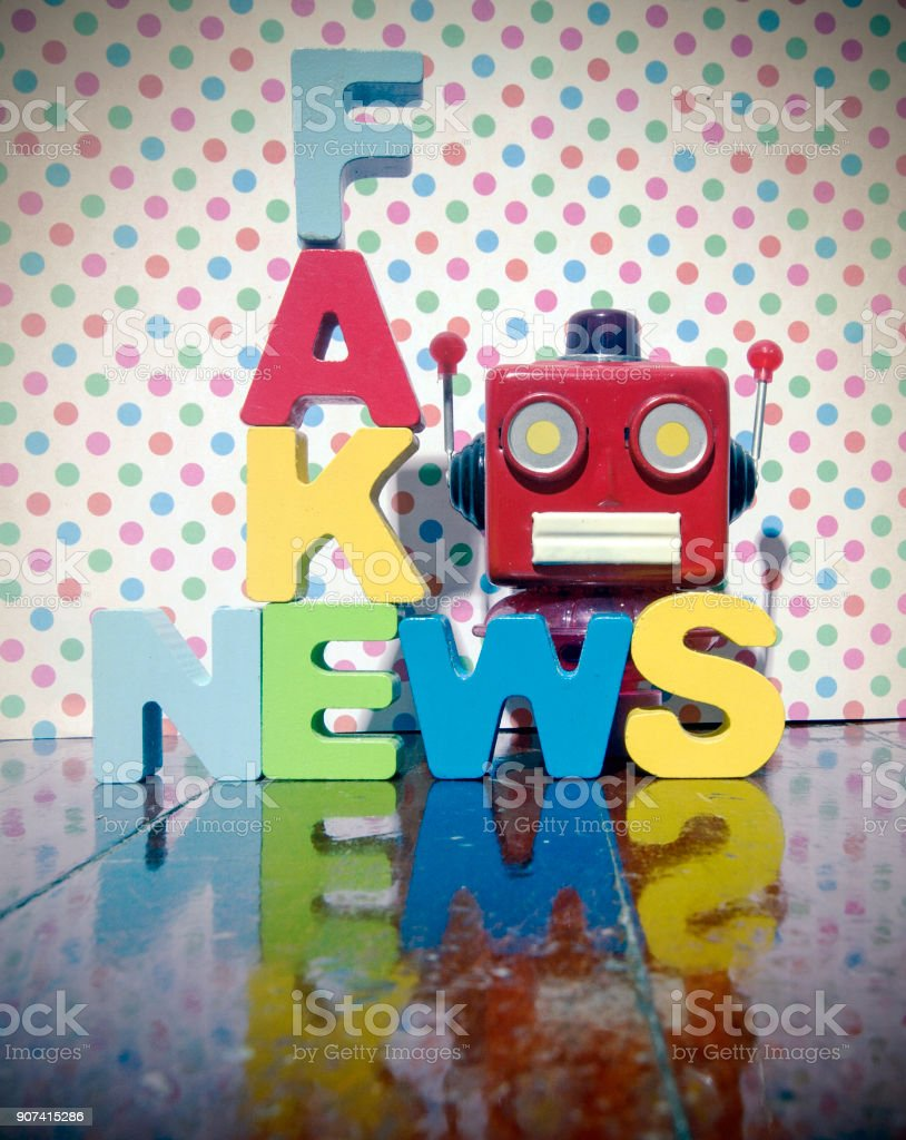 FAKE NEWS with wooden letters stock photo
