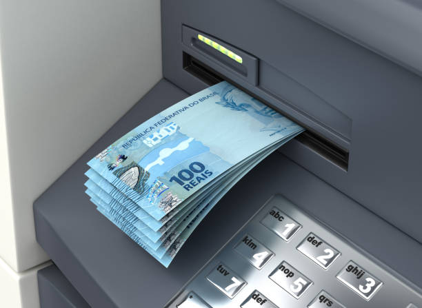 Withdrawal Brazilian Real From The ATM stock photo