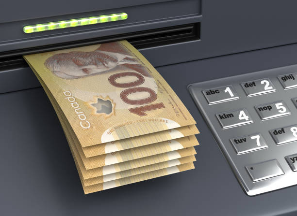 Withdrawal Canadian Dollar From The ATM stock photo