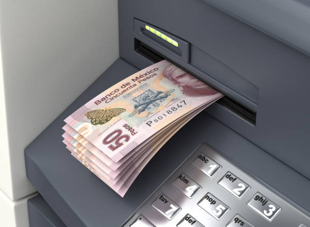 Withdrawal Mexican Pesos From The ATM stock photo