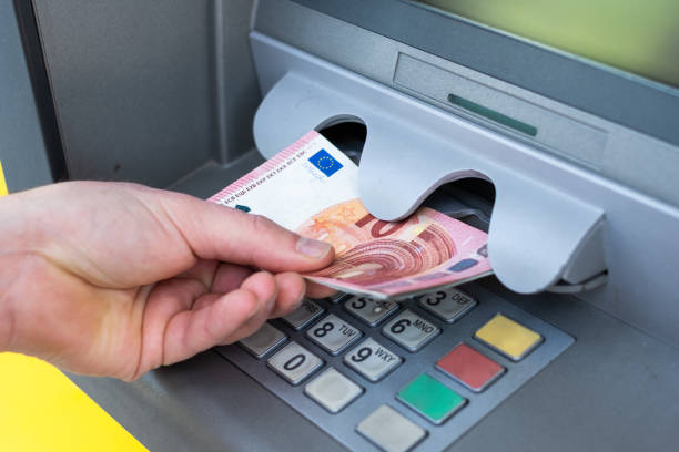 Withdrawing money from an atm bank machine stock photo