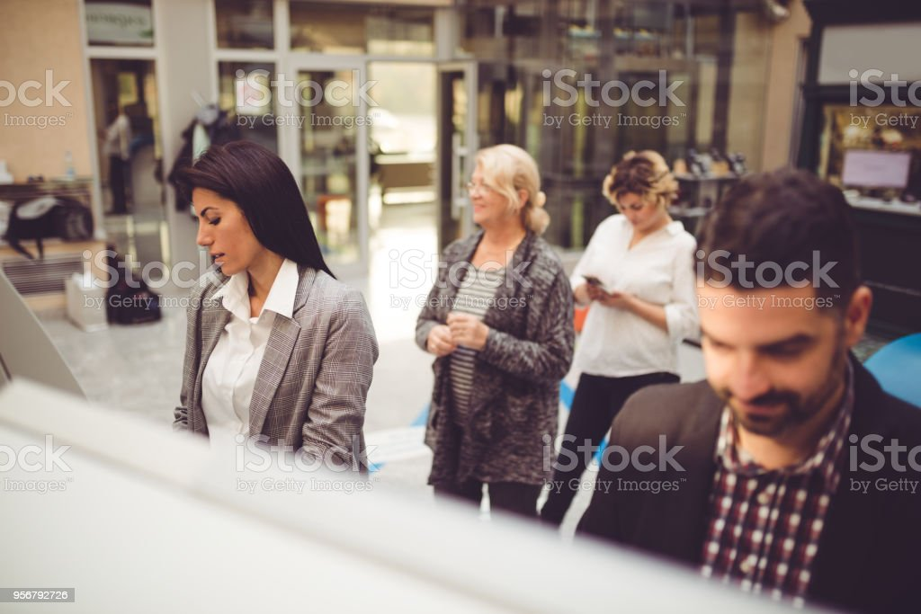 Withdrawing money from ATMs stock photo