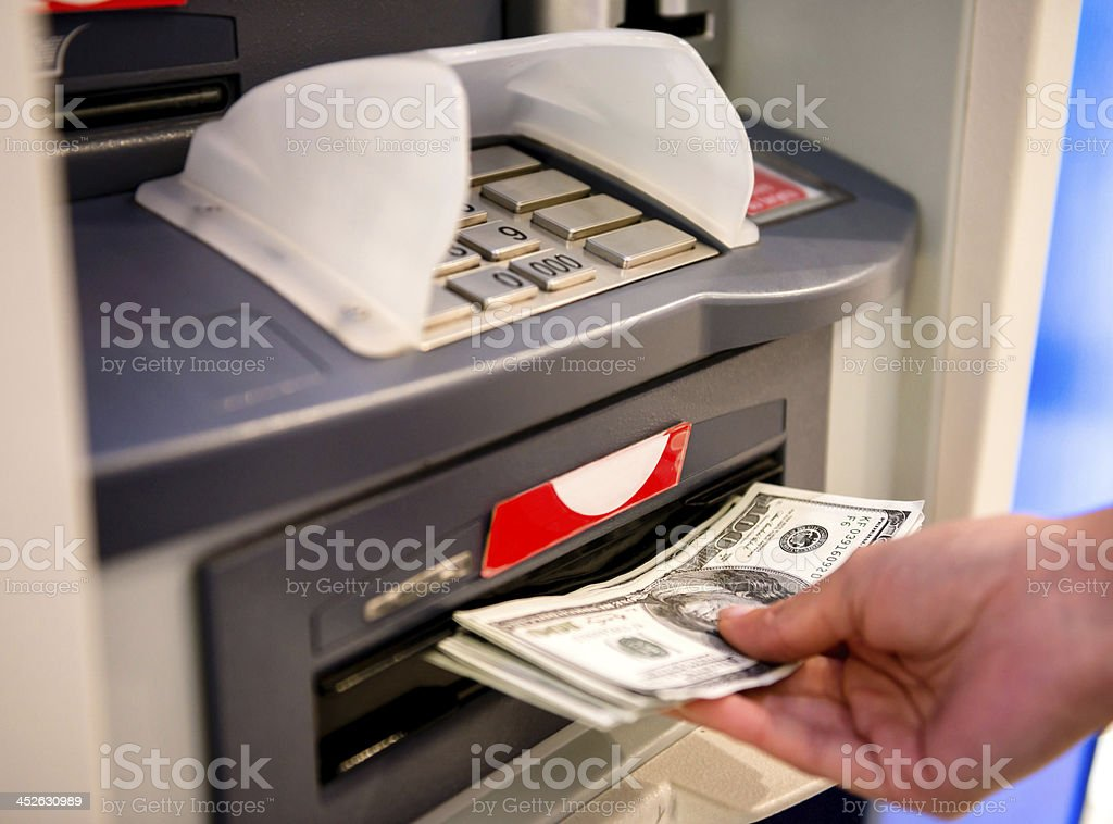 Withdrawing money stock photo