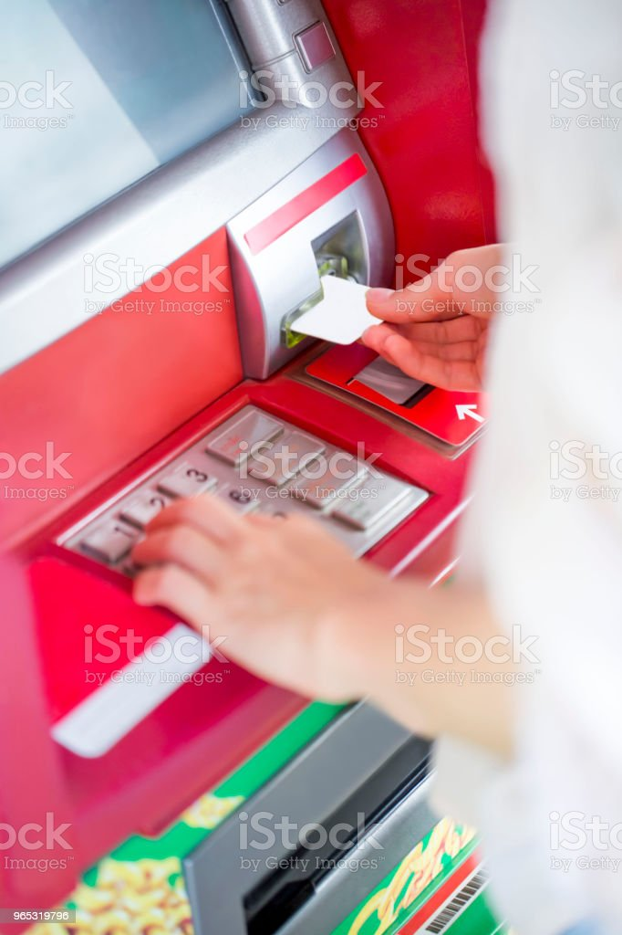 Withdrawing money royalty-free stock photo