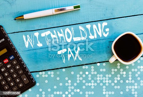 istock Withholding tax in blue table 1055158586