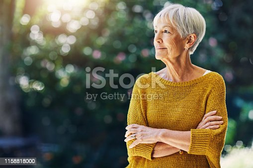 Shot of a confident senior woman looking thoughtful outdoors