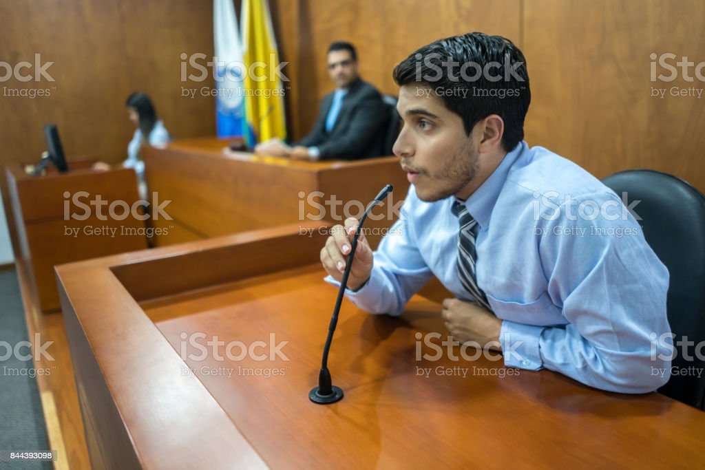 Witness addressing the courtroom in a trial stock photo