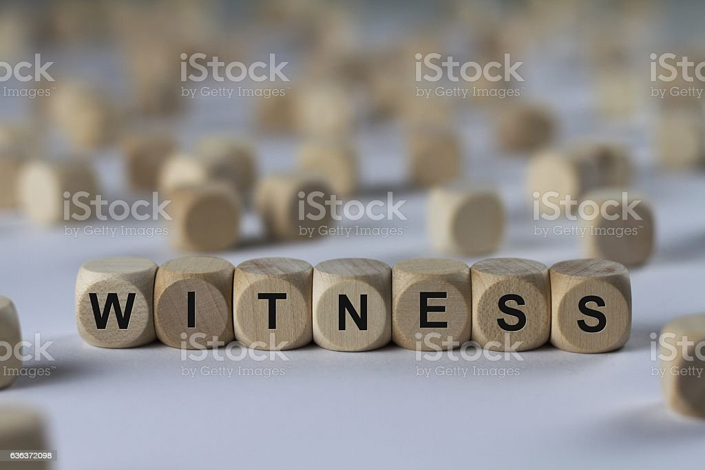 witness - cube with letters, sign with wooden cubes stock photo
