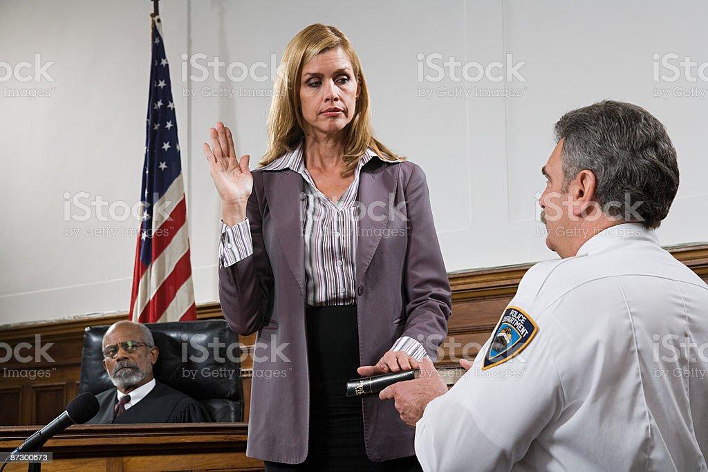 A witness swearing an oath stock photo