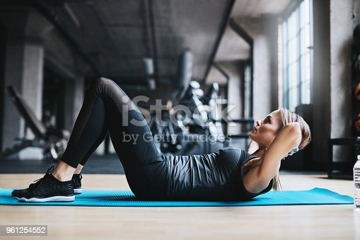 Full length shot of an attractive young woman working out in the gym
