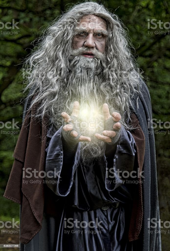 Wizard casting light spell stock photo