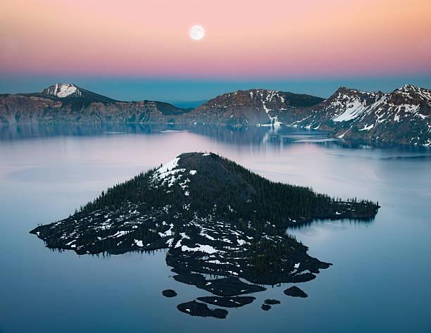 Wizard island and full moon stock photo