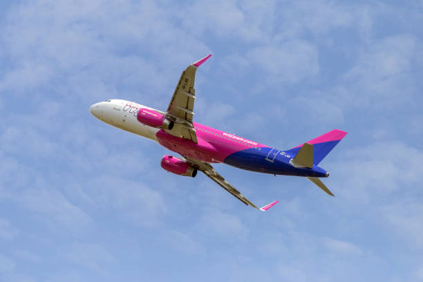 Wizz Air Airbus A320-232 is taking off from the Ferenc Liszt International Airport in Budapest, stock photo
