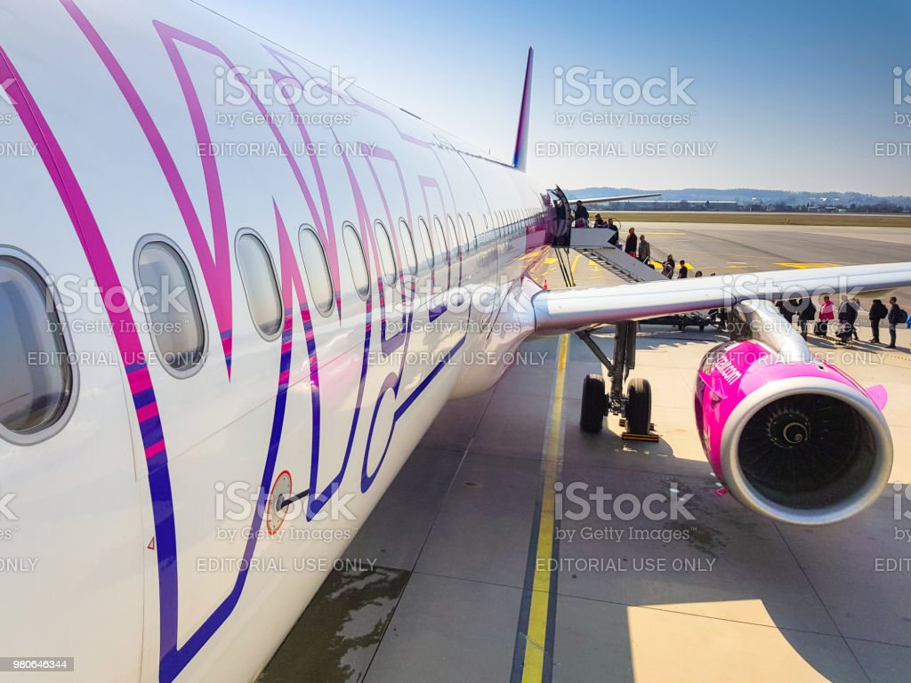 Wizz air plane on Lech Walesa Airport in Gdansk, Poland. Wizz air is a low-cost airline with largest fleet in Hungary who serves over 30 countries. stock photo