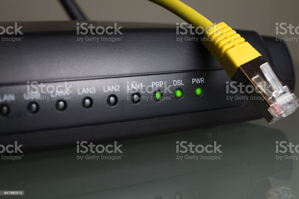 wlan, wifi, internet, cable router with a yellow twisted pair cable stock photo