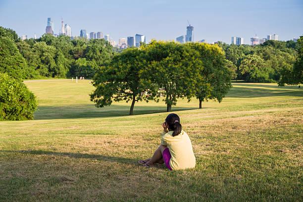 wman enjoying the view of Philadelphia in a park stock photo