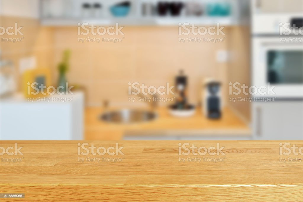 Wodden table with kitchen counter and sink background stock photo