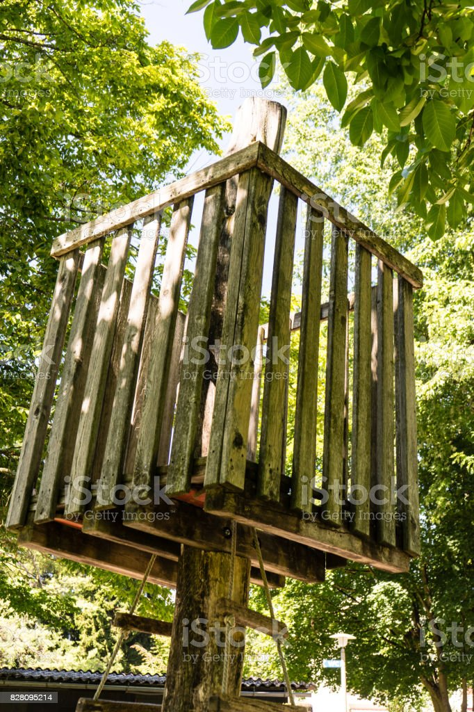 wodden tree house in the summer stock photo