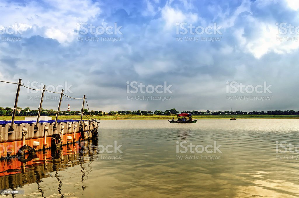 woden boat sailing in holy ganga water stock photo