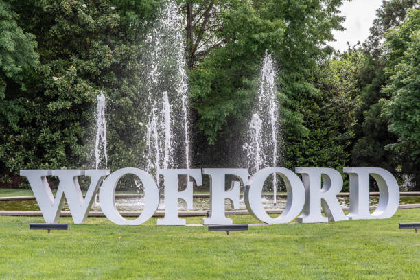 Wofford College in upstate S.C. Spartanburg, S.C. / USA - May 4, 2019: View of the sign at the entrance to Wofford College, located downtown Spartanburg. spartanburg stock pictures, royalty-free photos & images