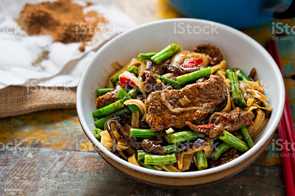 Wok fried beef & mushroom noodles stock photo