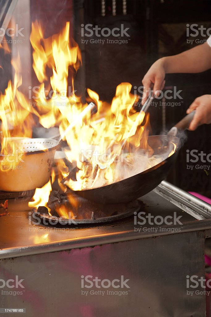 Wok frying with flames stock photo