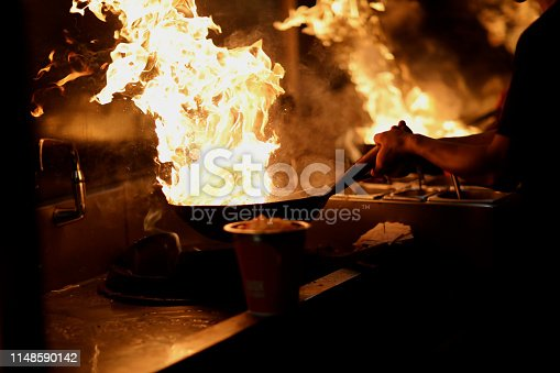 istock Wok with open flames in the kitchen 1148590142