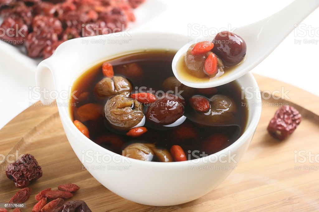Wolfberry jujube tea longan in tea cup on wooden tray stock photo