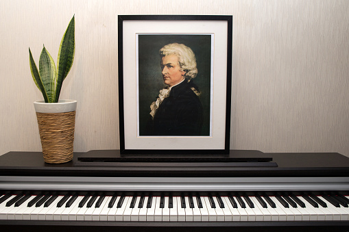 Wolfgang Amadeus Mozart - Portrait's photocopy of Burchard Dubeck painted in 1808 and piano keyboard.