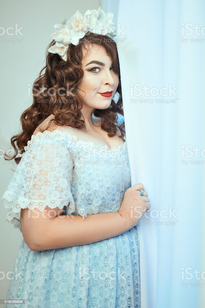Woman  a dress in the window. stock photo