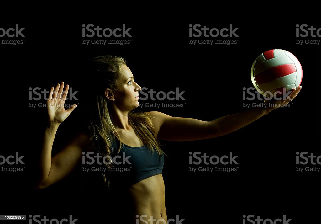 Woman About to Serve Volleyball, Isolated on Black stock photo