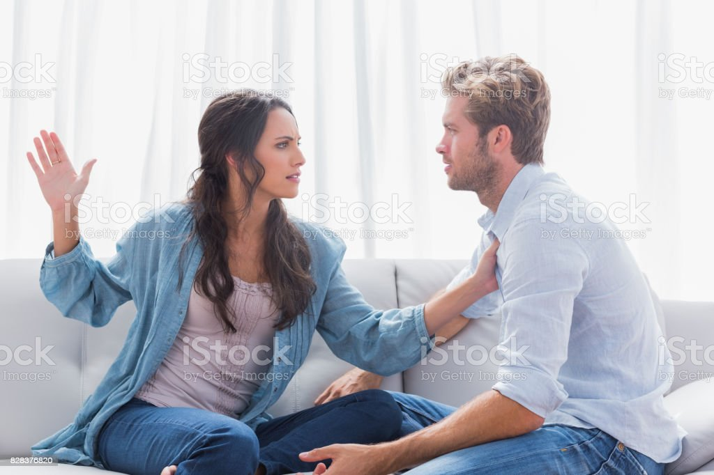 Woman about to slap her partner stock photo