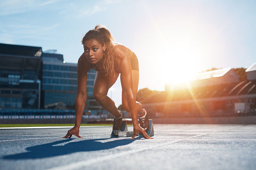 Woman About To Start A Sprint Stock Photo - Download Image Now