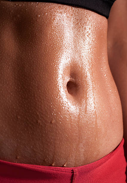 Woman Abs after workout stock photo
