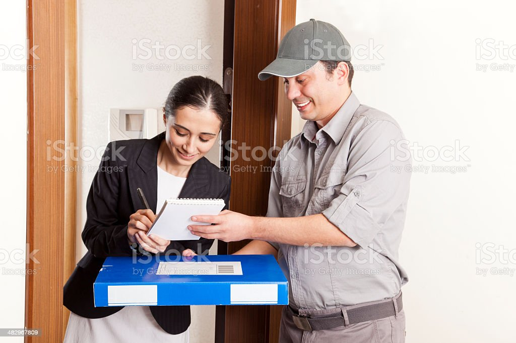 Woman Accepting a Package Delivery royalty-free stock photo