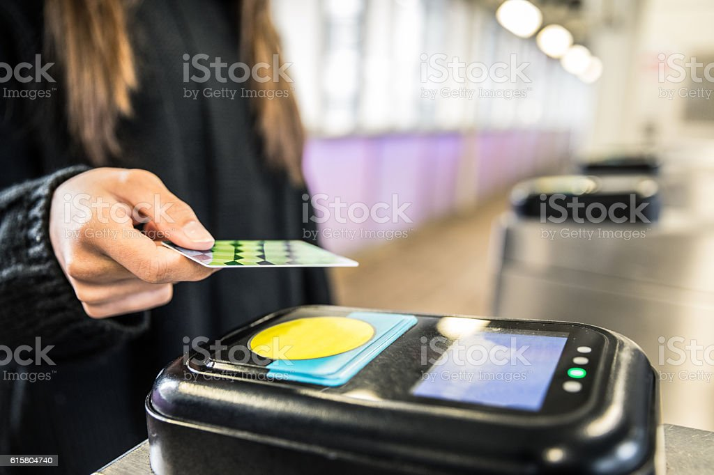 Woman access to the subway by contactless ticket stock photo