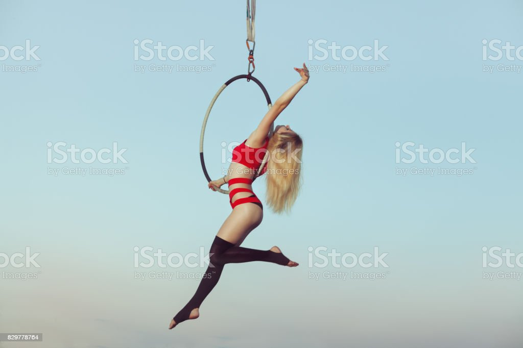 Woman acrobat in the air. stock photo